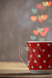 Red cup of tea in heart bokeh background Stock Photography