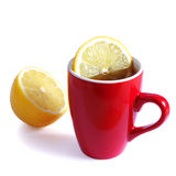 Red cup tea with lemon. On white Stock Images