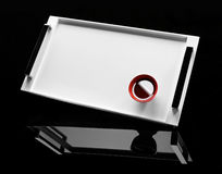 Red cup of tea on a white tray Stock Photos
