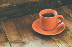 Red cup of tea on wooden old table. retro filtered image Royalty Free Stock Image