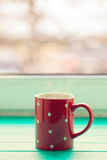 Red cup in white peas Royalty Free Stock Photography