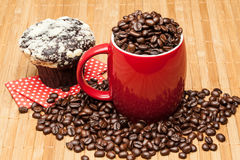 Red cup with whole  beans. Red cup with whole coffee beans Royalty Free Stock Image