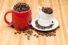Red cup with whole  beans. Red cup with whole coffee beans Stock Images