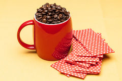 Red cup with whole  beans. Red cup with whole coffee beans Stock Photo