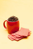 Red cup with whole  beans. Red cup with whole coffee beans Stock Photography
