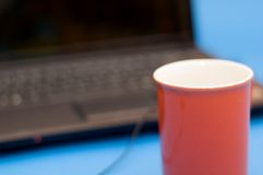 Red Cup With Notebook Stock Photography