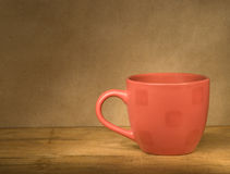 Red cup on a wooden table. Stock Images