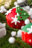 Red cupcake with Christmas symbol Royalty Free Stock Photography