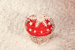 Red cupcake decorated with snowflakes Stock Photo