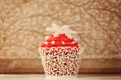 Red cupcake decorated with snowflakes Royalty Free Stock Photography