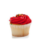 Red Cupcake with sprinkles on white Stock Photo