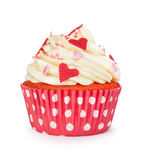 Red cupcake with vanilla cream and colorful sprinkles Royalty Free Stock Photos
