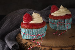 Red cupcakes with cream cheese frosting Stock Image