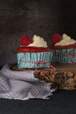 Red cupcakes with cream cheese frosting Royalty Free Stock Photo