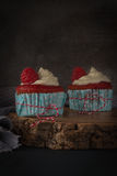 Red cupcakes with cream cheese frosting Stock Photography