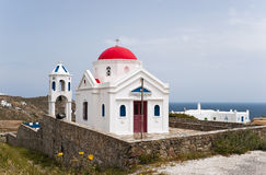 Red cupola church. With belltower near sea stock image