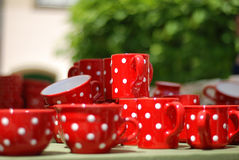 Red cups. With white dots Royalty Free Stock Photo