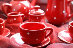 Red cups, saucers and teapot stock photography