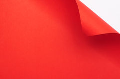 Red curl paper. Red paper sheet with corner curl blank space background stock image