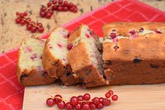 Red currant banana cake. Sliced red currant banana cake on wooden board Royalty Free Stock Image
