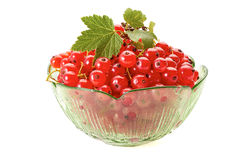 Red currant berries in green glass bowl on white Stock Photo