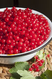 Red currant berries in a large bowl Stock Photo