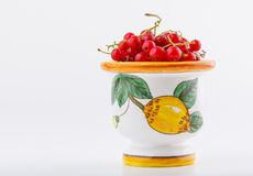 Red currant. Berries stacked in handmade coloured ceramic bowl isolated on white background stock photos