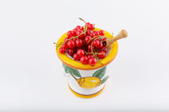 Red currant. Berries stacked in handmade coloured ceramic bowl on white background stock photography