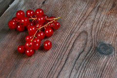 Red currant berries on wooden background with copyspace Royalty Free Stock Image