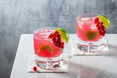 Two Red Currant Caipirinha Cocktails on Marble Bar Royalty Free Stock Photos