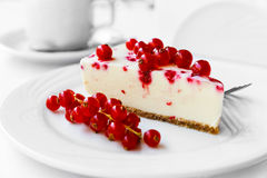 Red currant cake. Red currant cheesecake on plate with fork. Selective focus Stock Image