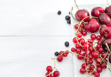 Red currant and cherry top view Stock Photography
