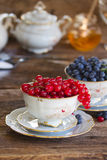 Red currant  in cup. Red currant berries  in cup on wood Royalty Free Stock Images