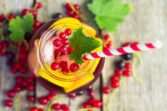 Red currant drink on wooden table Stock Photo