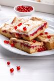 Red currant fruit pie bars with meringue on top.  royalty free stock image