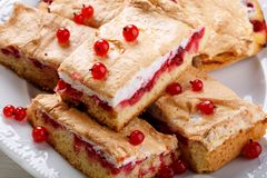 Red currant fruit pie bars with meringue on top.  stock image