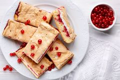 Red currant fruit pie bars with meringue on top. Top view.  stock photos