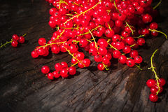 Red currant fruit scattered wooden bench table Stock Photo