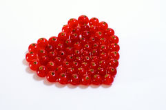 Red Currant in Heart form on white background Royalty Free Stock Photography