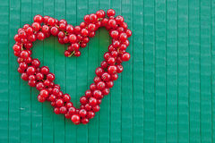 Red currant in heart-shape Stock Image
