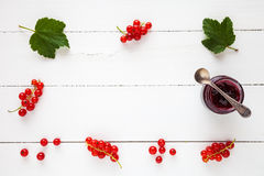 Red currant jam and fresh redcurrant berries as border Stock Photos