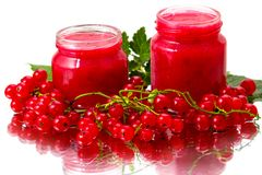 Red currant and jam jars Stock Photo