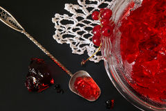 Red currant jelly in glass bowl against black background Royalty Free Stock Images