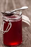 Red currant jelly in a jar stock image
