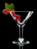 Red currant and leaf in wineglass Royalty Free Stock Image