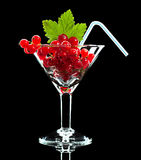 Red currant and leaf in wineglass with straw Stock Photos