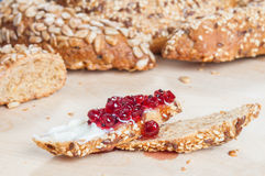 Red currant marmalade. With butter on freshly baked bread Royalty Free Stock Photo