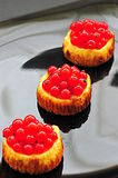 Red currant mini cheesecakes Stock Images