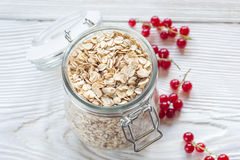 Red currant and oat flake in mason jar Stock Image