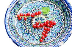 Red currant in oriental ceramic plate Royalty Free Stock Images